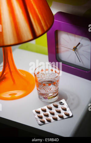Tablets on a night table. - Stock Photo