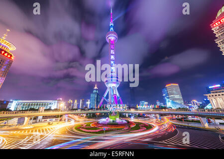 The Oriental Pearl Tower at night in Lujiazui Financial District of Shanghai, China. - Stock Photo