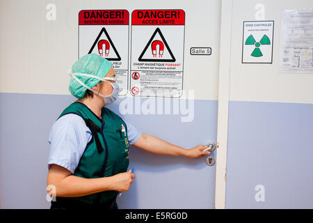 Radiation warning sign in radiology department at hospital. - Stock Photo
