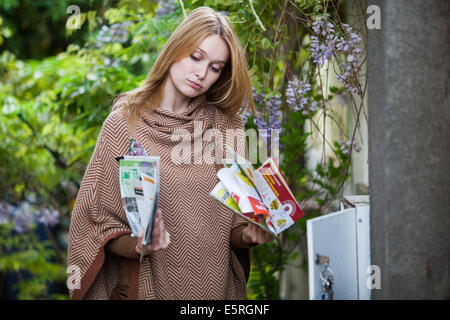 Woman opening box letter. - Stock Photo