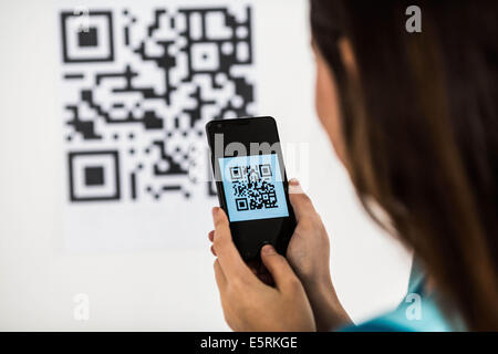 Qr Code photographed by a smartphone. - Stock Photo