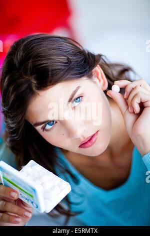 Woman wearing ear plug. - Stock Photo