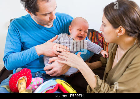 Crying 5-month-old baby boy. - Stock Photo