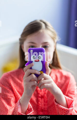 Teenage girl using a Smartphone. - Stock Photo