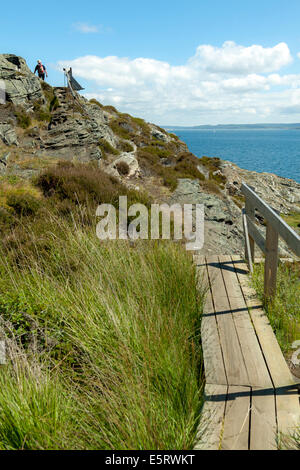 Hiking along the rocky coast on the island of Stora Dyrön, Tjörn Municipality, Bohuslan, Västra Götaland County, - Stock Photo