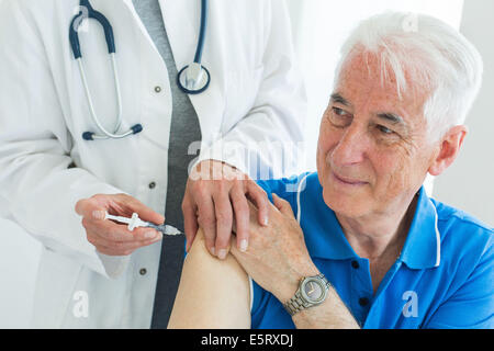 Man receiving vaccination. - Stock Photo