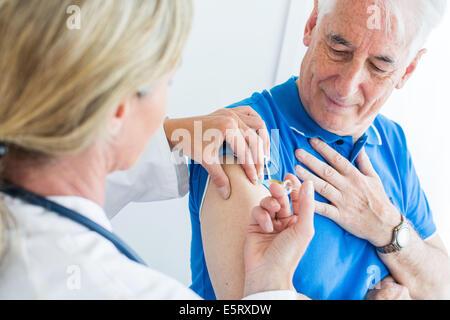 Man receiving Td Polio vaccination (Revaxis®). - Stock Photo