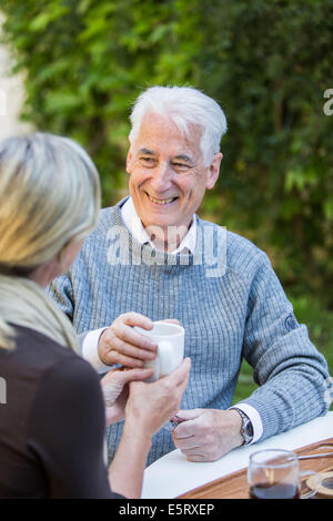 Woman assisting elderly man. - Stock Photo