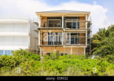 Beach front housing under construction on Bonita beach in Florida - Stock Photo