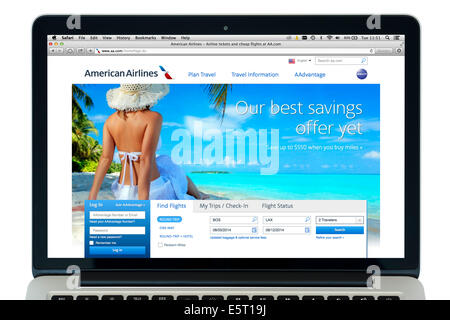 Booking an American Airlines flight on a 13' Apple MacBook Pro computer, USA - Stock Photo