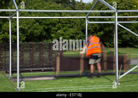 Showground construction team assembling marquees in Southport, Merseyside, UK. 'Temporary Event Industrial Equipment - Stock Photo