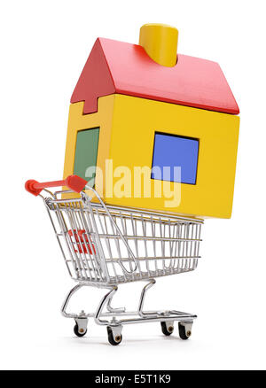 A toy wooden house in a shopping trolley - Stock Photo