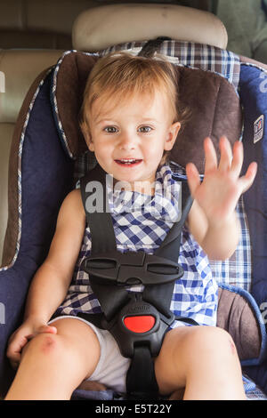 20 month old baby girl on a baby car seat. - Stock Photo
