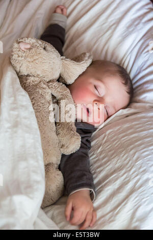 7 month old baby boy sleeping. - Stock Photo