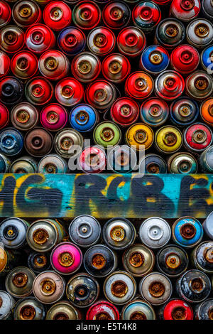Used spray paint cans stacked up in Berlin - Stock Photo