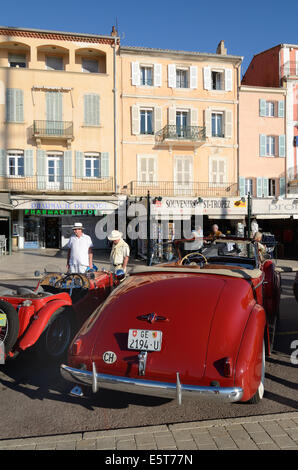 Veteran or Vintage Buick Eight Convertible Car, Cabriolet or Automobile Parked in front of Quayside Cafés at Saint - Stock Photo