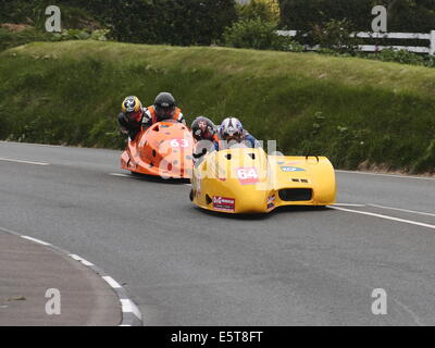 Sidecar outfits competing at the Isle of Man TT races 2014. - Stock Photo