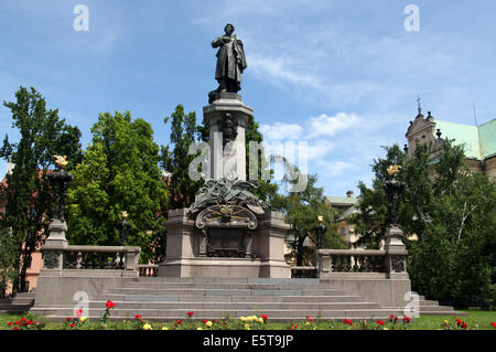 Adam Mickiewicz Monument in Warsaw which is next to the church of St Joseph of the Visitationists - Stock Photo