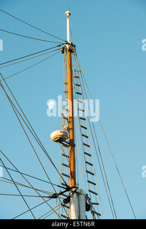 Looking up to see the moon next to the mast and part of the rigging of a 19th century tall ship. - Stock Photo