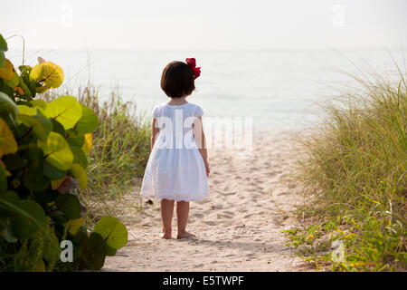Young Girl Staring at the Sea - Lauderdale-by-the-Sea, Florida - Stock Photo