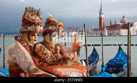 Costumed people on the Piazza San Marco during Venice Carnival. - Stock Photo