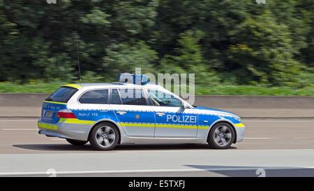German police car on the autobahn near Frankfurt. - Stock Photo