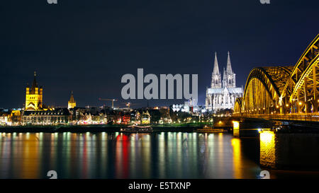 Riverside view of the Cologne Cathedral and railway bridge over the Rhine river, Germany - Stock Photo