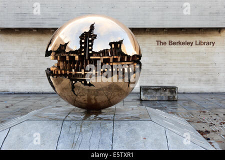 Abstract spherical metal sculpture on a courtyard of Trinity College in Dublin, Ireland. - Stock Photo
