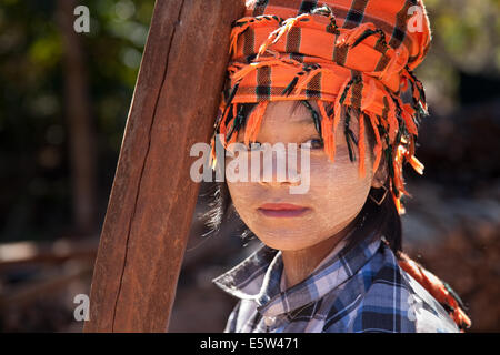 Pa-Oh girl wearing traditional tribal headwear and thanatkhar on her face. Shan state, Myanmar (Burma). - Stock Photo