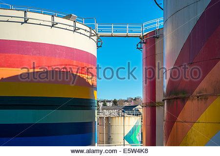Colorful petrochemical storage tanks used for storing liquid gasses, La Souterraine, La Creuse Department, Limousin, - Stock Photo