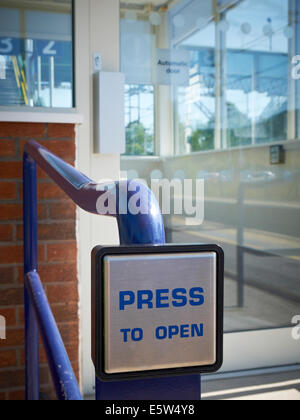 Press to open button for opening automatic door - Stock Photo