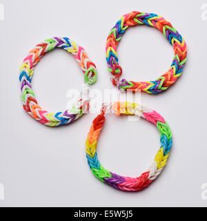 Three colourful loom bands bracelets - Stock Photo