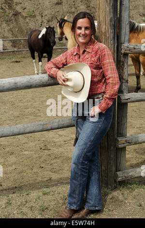 A woman with a cowboy hat at La Reata Ranch near Kyle, Saskatchewan, Canada. - Stock Photo