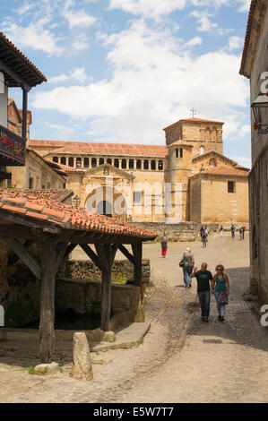 Couple walking past old wash house near Santa Juliana collegiate church, Santillana del Mar, Cantabria, Northern - Stock Photo