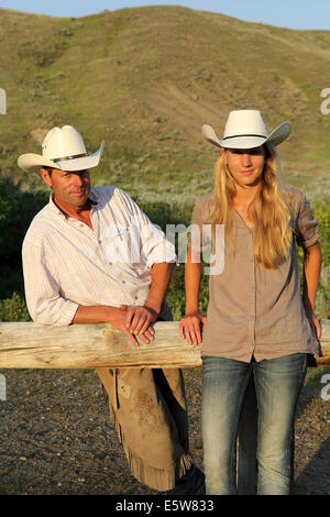 A cowboy and cowgirl at La Reata Ranch near Kyle, Saskatchewan, Canada. - Stock Photo