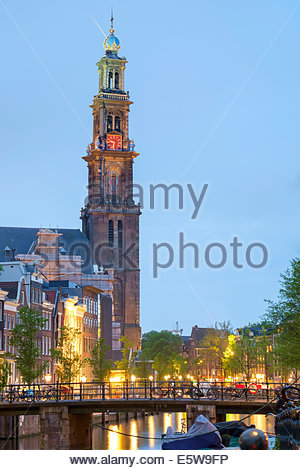 Prinsengracht canal and tower of the Westerkerk church at dusk, Amsterdam, North Holland, Netherlands - Stock Photo