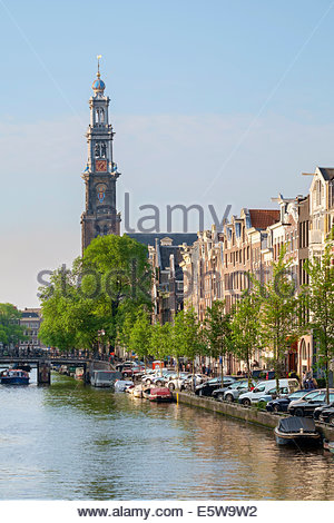 Tower of the Westerkerk church on the Prinsengracht canal in late afternoon, Amsterdam, North Holland, Netherlands - Stock Photo