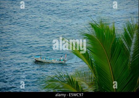 Fisherman along the Pacific coast of Acapulco, Mexico - Stock Photo