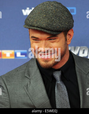 Cologne, Germany. 06th Aug, 2014. Actor Kellan Lutz arrives for the premiere of the movie 'The Expendables 3' in - Stock Photo