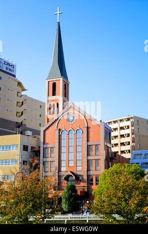 Modern Japanese church or wedding chapel with steeple: Kobe, Japan - Stock Photo