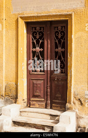 Wooden doors leading into crypt in the Greek Orthodox cemetery in Convent of St George in Coptic or Old Cairo, Egypt - Stock Photo