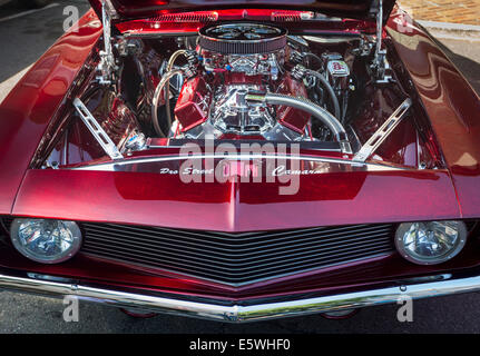 Classic car engine compartment of a vintage car red Chevrolet Camaro, USA - Stock Photo