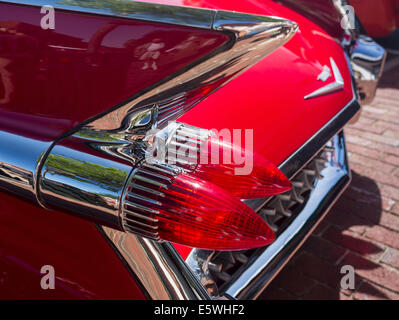 Tail lights and fins of 1959 red Cadillac Eldorado antique classic car, USA - Stock Photo
