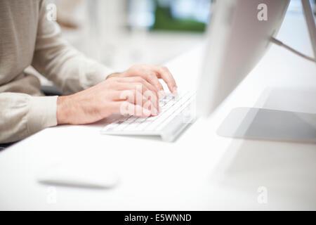 Man using computer keyboard, close up - Stock Photo