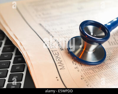Financial health check: stethoscope on newspaper with financial markets for investing - Stock Photo