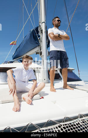 Father and son sailing catamaran off Fuerteventura, Spain - Stock Photo
