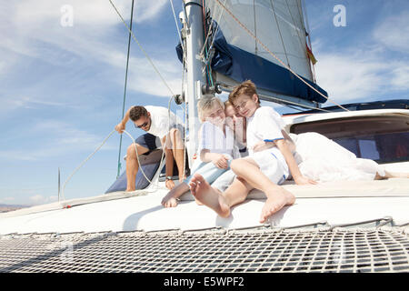 Parents and two sons on catamaran near Fuerteventura, Spain - Stock Photo