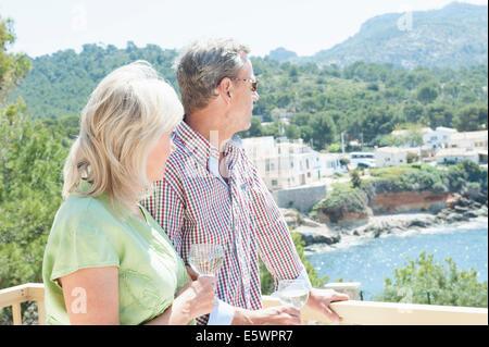 Couple celebrating on holiday, Mallorca, Spain - Stock Photo