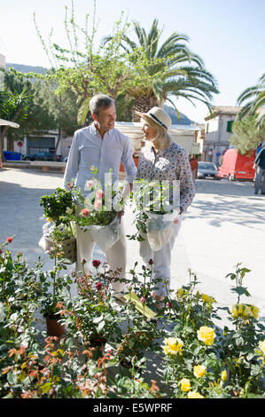 Couple shopping at flower market, Mallorca, Spain - Stock Photo