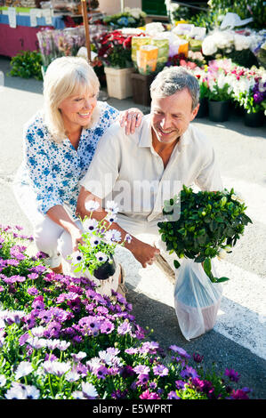 Couple shopping at flower market, Mallorca, Spain - Stock Photo